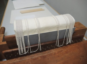 Conservators fixing the new binding in place.